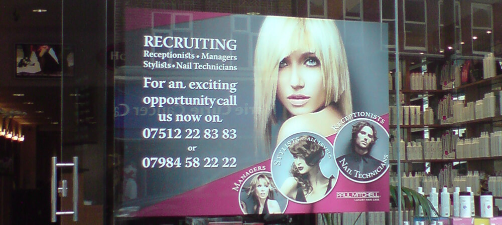 Large format window poster for Paul Mitchell Hair Salons