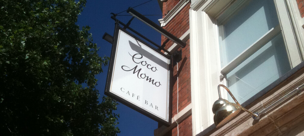 Hanging sign for Coco Momo Cafe Bar