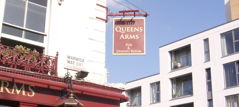 Signage for The Queens Arms public house