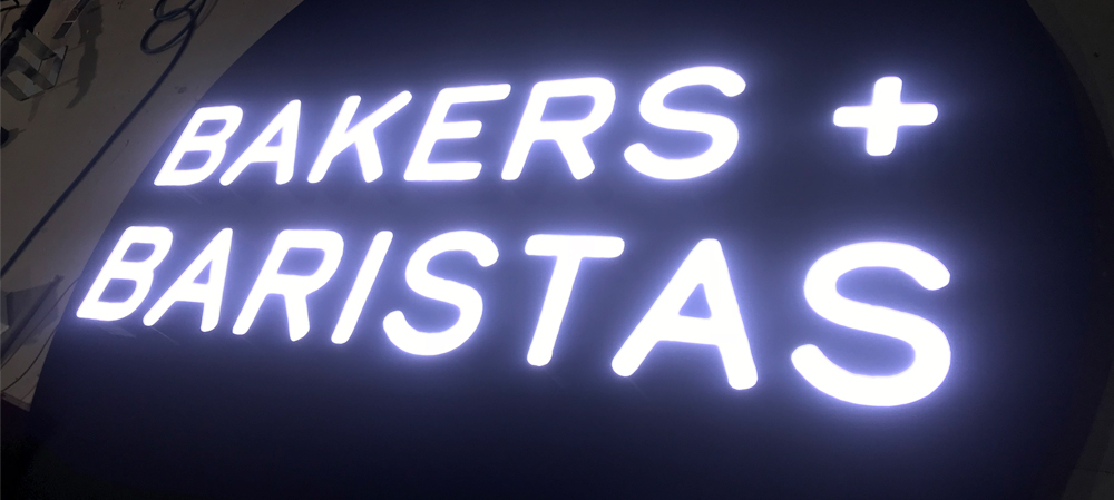 bakers and baristas illuminated signage