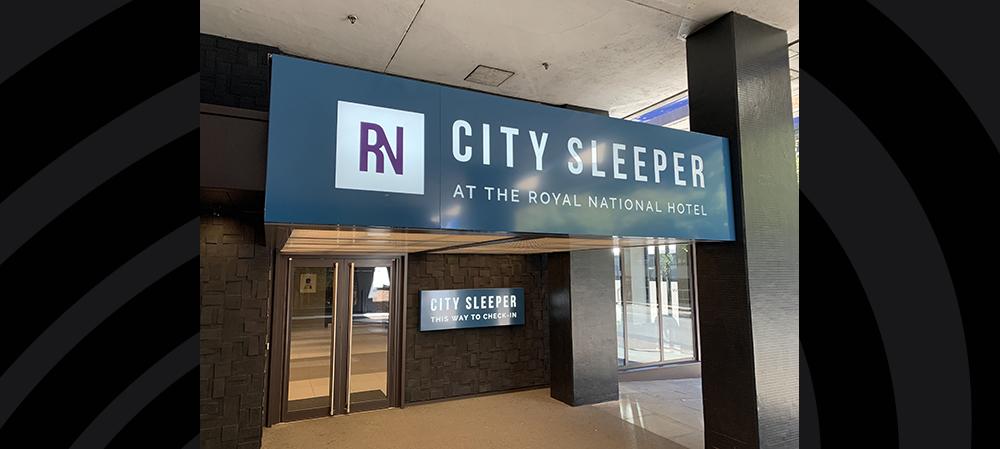 City sleeper hotel entrance signage