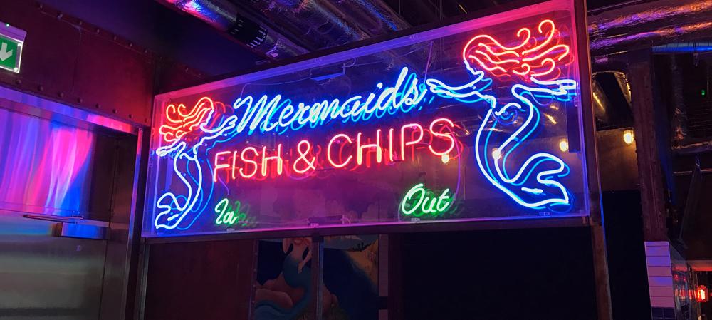 mermaids fish and chips illuminated signage