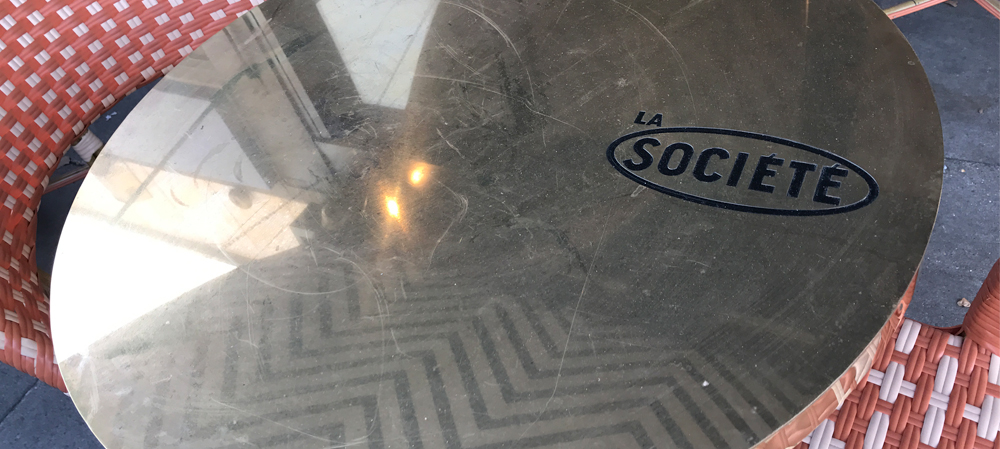 la societe mirrored table with graphics logo