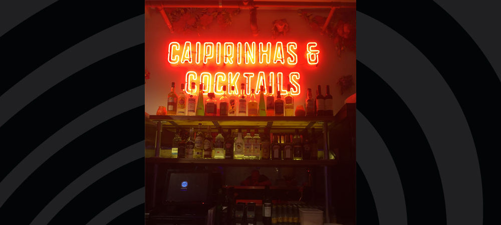 illuminated internal signage for cocktail bar