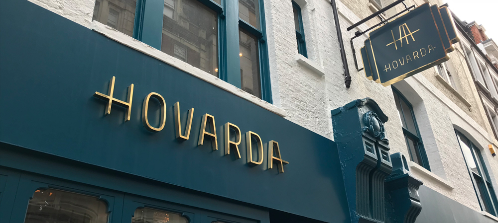 gold external illuminated shop front sign for hovarda