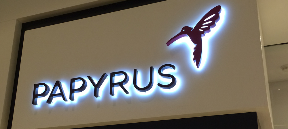 illuminated store front sign for papyrus